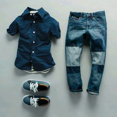 Little boy clothes in all blue... patchwork denim pants, blue short sleeve button up and blue sneakers.