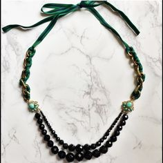 Multi Strand Beaded Gold Tone Statement Necklace Gorgeous Multi strand Black Beaded Gold toned necklace with navy and green tie closure.  Adorned with Turquoise And gold toned accents.  Pristine condition!!  I do not have original box - but will ship in a designated necklace box Talbots Jewelry Necklaces