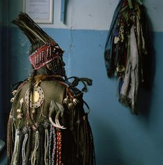 A Tuvan shaman in her ceremonial headdress and coat. Photo by Lynn Johnson / National Geographic Stock