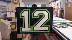 Showing Signs of Seahawk Support: Seattle-area FastSigns is producing '12th-man' banners to urge on Super Bowl fans and raise money for a local hospital.  http://bigpicture.net/content/showing-signs-seahawk-support