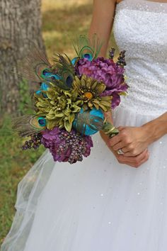 Peacock Wedding Bouquet - Purple Peacock Feather Bouquet. $100.00, via Etsy.
