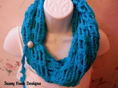Fashion Statements Infinity Scarf – Crocheted scarf in turquoise shimmer with button tie. Versatile styles in one scarf.