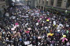 Demonstrators march across 42nd Street during a women's march on January 21, 2017, in New York