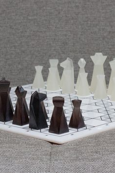 This #chessset has a #sleek, #sophisticated appearance, putting a #modern twist on a traditional #game. The #chessboard is laser engraved with a #polygonal texture to compliment the look of the #chesspieces. All pieces are hand casted in #translucent #colorful #resin. PLA Chess is an amazing #gift for anyone who loves playing #chess or wants to display their set as a #decorative accessory for their home. #chessdesign #design #creative #decor #faceted #industrialdesign #productdesign #sale Wood Turning Projects, Wood Projects, Woodworking Projects, Lathe Projects, Wood Router, Wood Lathe, Cnc Router, Modern Chess Set, Wood Games