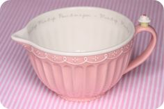 pink bowl with spout and cupcake