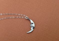 Crescent Moon Necklace in Sterling Silver. $28.00, via Etsy.