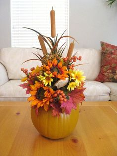 Pumpkin Floral Arrangement, Thanksgiving Centerpiece, Fall Table Arrangement, Thanksgiving Decorations    Our Fall Pumpkin Floral Centerpiece Arrangement will look amazing anywhere you display it: kitchen table or hutch, dining table or buffet, coffee or side table, etc. We filled a craft pumpkin with a selection of fall leaves, flowers, berries and cattails in rich autumn shades of green, gold, yellow and orange    The Fall Pumpkin Floral Centerpiece Arrangement makes a perfect autumn…