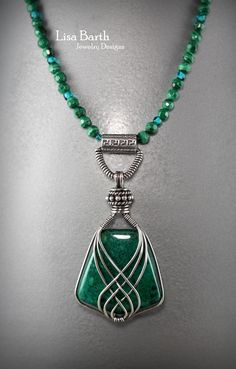A beautiful Chrysocolla cab that I wrapped with my criss cross design.  You can learn how to do this too, here is the tutorial:  https://www.etsy.com/listing/156274277/criss-cross-pendant-tutorial?ref=shop_home_active_5