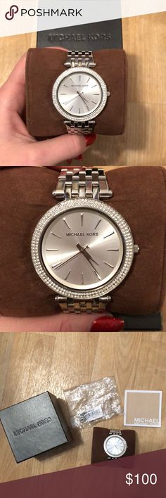 Silver Michael Kors Watch In very nice condition! Minor signs of wear on the band, but that comes from wearing the watch at all. Comes with everything pictured, but does not have a working battery. Michael Kors Accessories Watches