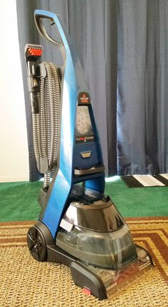 Bissell ProHeat 2x Premier Upright Cleaner will get your home sparkling this holiday season! Click through for a coupon off Bissell's cleaning formulas!