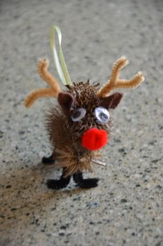 Teasel Weed Reindeer. Take two dried teasel weeds, add eyes, felt ears, a pom pom red nose, pipe cleaner antlers and legs and a ribbon for hanging...viola...instant cuteness.  visit www.noplacelikehappyfortheholidays.blogspot.com for 40 days of holiday crafts, activities and more starting November 22nd