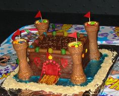 Another castle cake option for non cake decorators. Details can be achieved with candies, pretzels, ice cream cones, etc. I've used fruit roll-ups on toothpicks or spaghetti for the flags in the past. This one was made my another pinner for her son, after making one for her daughter.