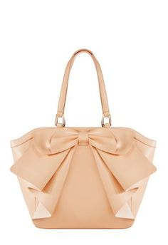 I love the soft blush color of this bag with the large statement bow. I can definitely see this bag in my future for Spring! #justfabsweeps