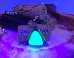 Blacklight glowing sea glass necklace