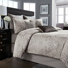 Outfit your bedroom in style with the beautiful Wamsutta® Cambridge Comforter Set. The perfect blend of sophistication and elegance, the luxurious bedding features a scrolling charcoal damask motif on a grey background.