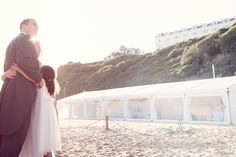 Bride and groom hug at Bournemouth Beach wedding. Photography by one thousand words wedding photographers