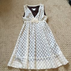 Cream Lace Dress! Cream lace dress with brown lining. Only worn once :) cute bow accent on the front. Open to reasonable offers! Charlotte Russe Dresses Mini