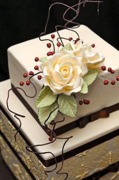White gum-paste rose on multi-tier cake . . .