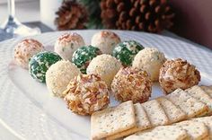 Holiday Cheese Truffles recipe. They may look as cute as holiday chocolates. but these mini cheese balls are made for those of us who love a little cayenne and sharp Cheddar on our party plate.