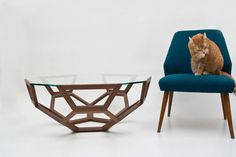Celebrating the hexagon, IkoIku Coffee Table by Peter Christian Rohnke combines the traditional appeal of oiled walnut and glass with a light, modern geometric form.