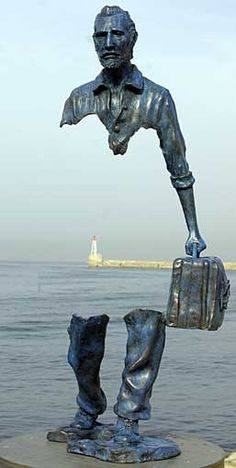 The following images look like an optical illusion or a Photoshop trickery. But closer inspection reveals that the upper half isn't mysteriously floating in air but cleverly connected to the bottom half of the statue. These unusual Travelers statues were designed by French sculptor Bruno Catalano.