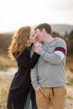 a couple kissing red shoulder length hair posing for an engagement photoshoot in ireland Ireland Beach, Catch A Flight, I Respect You, Couple Kissing, Donegal, Shoulder Length Hair, Engagement Shoots, Red Hair, Most Beautiful