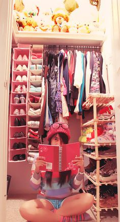 Organized small closet for a girl with an excessive amount of shoes