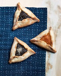 Hamantaschen: 4 cups all-purpose flour  1 teaspoon baking powder  2 teaspoons Diamond Crystal kosher salt  Zest of 1 lemon  4 large eggs  1 cup sugar  1 cup canola oil  1/4 cup lukewarm water    For the apricot or prune filling:  2 cups dried apricots or dried prunes  1 cup sugar  1 cup water    For the poppy-seed filling:  1 cup poppy seeds  1 1/2 cups dark raisins  1 1/2cups golden raisins  1/2 teaspoon ground cloves  1/2 teaspoon kosher salt  1/2 tspn ground cinnamon  1 c sugar  2 cs…