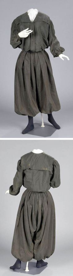 Bicycle dress, ca. 1895-1905. Machine-stitched dark gray wool. Two pieces: bodice and bloomers. Bodice has a sailor collar and full sleeves and is gathered into band at waist. Placket covers metal snap closure at center front. Very full bloomers, gathered into waistband with wide knife pleats, that close with snaps over left hip. Connecticut Historical Society emuseum.