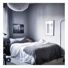 COZY || A peaceful and serene bedroom vibe... the grey color scheme and chandelier of feathers make this so soft and cozy. #Inspiration #Interiors #Luxury #LuxuryLife #BeyondLuxury #Bedroom #Modern #ModernDesign #Design #InteriorDesign