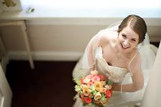 Another smiling bride. Flowers by Regalo Design.