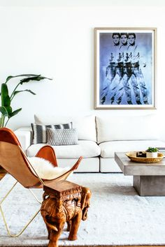 Put 'em up! A Warhol Elvis print watches out over the white modular sofa. Or maybe he's dueling with the wooden elephant, a Leistner family heirloom?