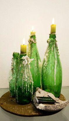 Reusing bottles as candle holders... genius!