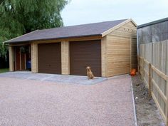 Triple Timber Garage with Brown Up and Over Metal Doors and Felt Tiles Brown Roof Houses, House Roof, Timber Garage, Garage Roof, Metal Doors, Double Doors, Winchester, Tiles, Shed