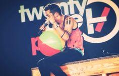 Tyler from Twenty One Pilots performing