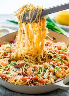 Delicious Shrimp Scampi with Bacon over linguine. Try this recipe if you love shrimp scampi, the bacon adds that extra bit of flavor that is incredible. #shrimpscampirecipeswithrice