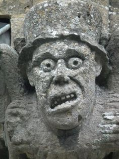 Gargoyle on an ancient cathedral. human expressions have not changed much. actually, this doesn't look like a gargoyle as they are designed to spew rainwater from the mouth. this is likely a 'grotesque' or a corbel which is under a ledge or shelf and looks like it is holding it up.