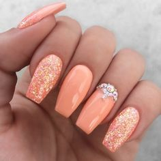 Girly peach glitter rhinestone nails. Are you looking for peach acrylic nails design? See our collection full of peach acrylic nails designs and get inspired! #naildesigns