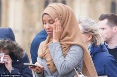 London Attack: This Photo Of A Muslim Lady Walking Past Victim Got People Talking