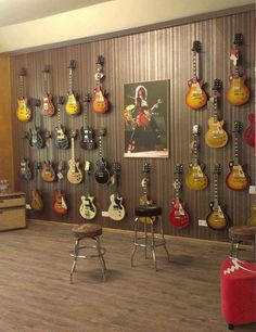 http://custard-pie.com/ Wall of Jimmy Page's Les Paul Signature guitars on temp loan for shot....