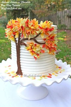 Such a pretty cake design :) Autumn Leaves in Chocolate- A free MyCakeSchool.com blog tutorial!