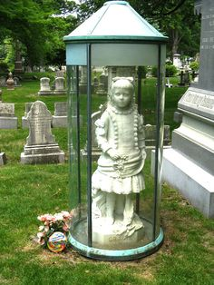 Grace Sherwood Allen died in 1880, at 4 years old. Her distraught parents commissioned Sydney H. Morse to execute this life size marble statue.  Someone has thoughtfully left her a lollipop..