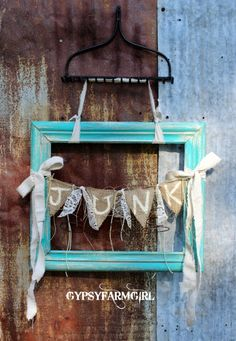 Love the pop of color from the turquoise frame.
