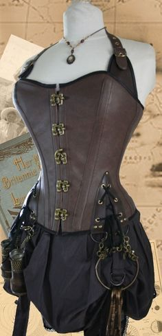 A unique Steampunk Corset. A perfect accessory for any budding Steampunk Lady Adventurer, Air Pirate, Explorer or Spy. Swashbuckling Steampunk corset full brass fixings.