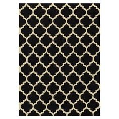 """Hand-hooked rug with a Moroccan tile motif.   Product: RugConstruction Material: 100% PolyesterColor: Black and creamFeatures:   Handmade0.23"""" Pile height"""