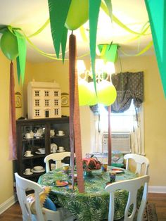 Dino party. Love the ceiling decorations!