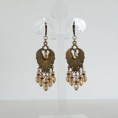 Check out this item in my Etsy shop https://www.etsy.com/listing/93425997/gold-teardrops-crystals-and-bronze