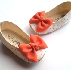 Our Clementine soft sole toddler girl shoes are so charming! They are made with a white and orange polka dot fabric and embellished with an exquisite orange chiffon bow at the toe. Great for spring and summer outfits or even as an accessory to your flower girl's outfit.Bitsy Blossom's baby shoes are all handmade and created with great care and attention to detail. All of our shoes are made with modern and unique textiles. The insole is lightly padded for extra comfort. The solin...