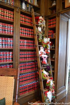 """""""Tour a Beautiful Victorian Home Decorated for Christmas, Part II -- ...belonging to [Georgia former] Governor Roy and Marie Barnes. ...Looks like Santa and his elves have taken over the library steps for now..."""" -- Not quite the books themselves as decor, but the decorated ladder was too cute not to pin."""