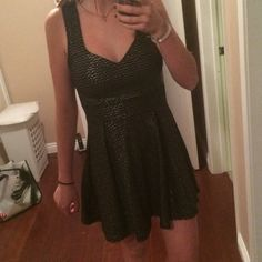 Black and Gold lace back skater dress Beautiful black skater dress with gold threads. Beautiful black and gold lace back! Super pretty and would flatter any body type! New and never worn (other than try on). WINDSOR Dresses Mini